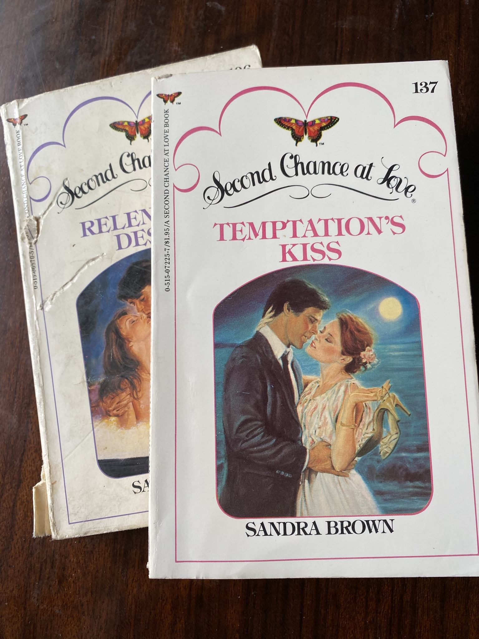 Two books from the Second Chance at Love imprint. The top book is Temptation's Kiss by Sandra Brown.